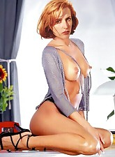This is Gillian Anderson - hot and famous redhead who loves to show her tits on camera!